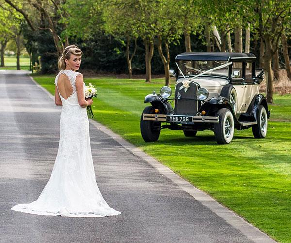 Wedding bride and vintage car