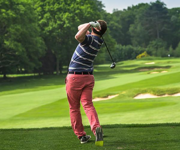 Golf swing man striped top
